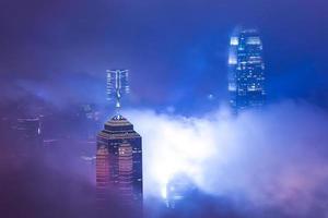 Skyscraper in fog photo