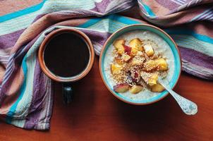 Oatmeal with peaches, flax and maple syrup