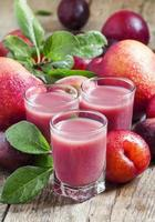 Delicious fresh juice of red and blue sweet plums