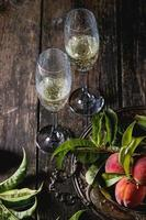 Peaches on branch with champagne photo