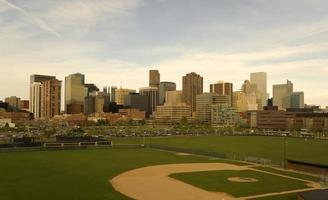 Downtown Denver, Colorado is next to a baseball field  photo