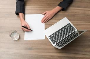 businesswoman signs document photo
