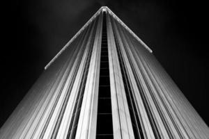 Torre Picasso business building illuminated at night in Madrid