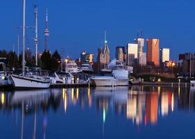 Predawn Toronto skyline with reflections