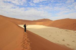 Tourist in the Sossusvlei desert, Namibia photo