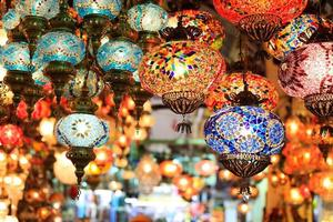 Set of colorful lanterns with oriental patterns at a bazaar photo