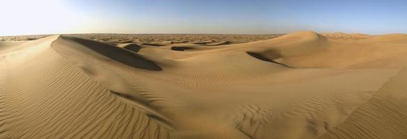 Empty desert with sand dunes and no roads