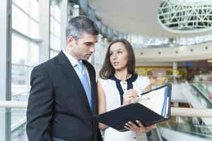 Businessman and woman discussing work photo