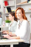 Teamwork at modern graphics studio photo