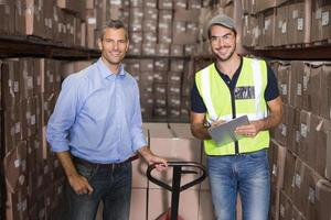 Warehouse manager and foreman working together photo