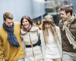 Happy young friends walking together outdoors photo