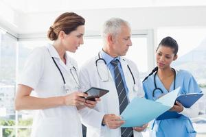 Doctors working together on patients file