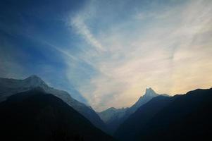 Annapurna range. cloudy vivid sunset. Nepal Himalaya