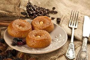 Turkish Ramadan sweet - Sekerpare with wooden background photo