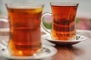 Two cups of turkish tea on a table in Istanbul photo