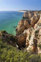 Coast with cliffs in Lagos at Algarve in Portugal