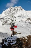 Hiker walks on train in Himalayas photo