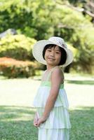 Asian child with summer hat photo