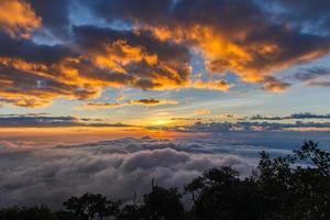 Layer of mountains and mist at sunset time photo