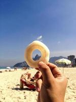 Playing with fried froth on the beach. photo