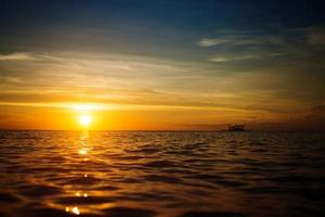 Boat and sunset photo