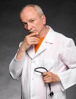 Medical doctor with stethoscope photo