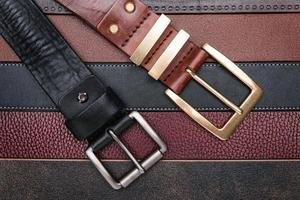 Close-up of two men belts photo