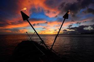 Tiki torch sunset photo