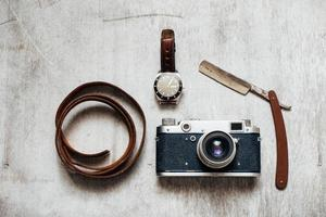 Men's Accessories , on a wooden background Retro camera watch razor