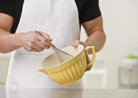 Man With Whisk and Bowl