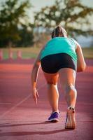 Female runner on an athletics track