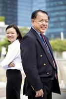 Asian businessman and young female portrait