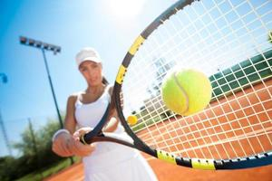 Sporty female tennis player in action