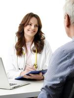 Female doctor talking with old patient photo