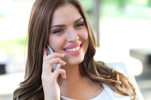 Beautiful Female Business Executive On Cell Phone
