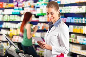 Female pharmacist in her pharmacy photo