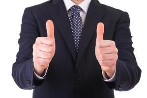 Hombre de negocios que muestra los pulgares arriba signo. foto