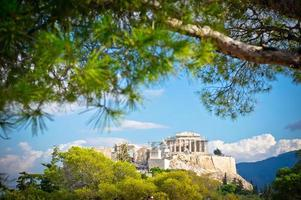 Tree framed view of ancient Acropolis in Athens Greece
