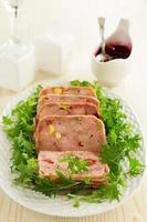 Duck terrine with pistachios and cherries. photo