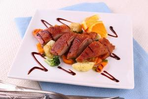 Roasted duck breast fillet, vegetables with orange