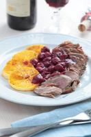 Duck meat with orange and cherry sauce photo