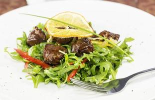 salad of arugula and duck meat