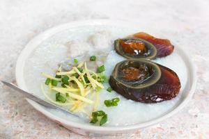 Porridge with century egg or preserved duck eggs.