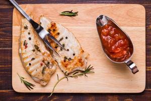 Grilled turkey steak on a cutting board