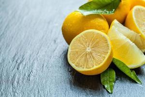 Fresh lemon on black stone