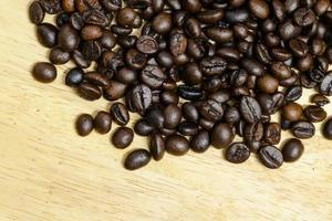 Coffee bean on wooden background.