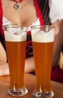 Woman in Dirndl drinking wheat beer photo