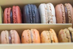 French colorful macarons on wood table