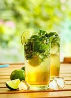 Mojito with lime on the table photo
