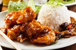 Fried chicken pieces with sweet and sour sauce photo